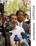 NEW YORK - JUNE 29: NY Governor David Paterson (C) speaks to the press as he attends the Pride Parade on June 29, 2008 in New York City. - stock photo
