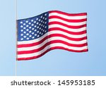 the american flag in the wind... | Shutterstock . vector #145953185