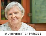 Senior Woman On The Veranda Of...