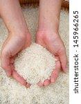 hand holding jasmine rice grain. | Shutterstock . vector #145966265