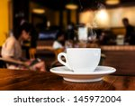 Stock photo cup of coffee on table in cafe 145972004