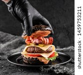 chefs hand in black glove... | Shutterstock . vector #1459753211