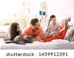 Stock photo happy family with cute cats on bed at home 1459912391