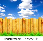 Wooden Fence With Green Grass...
