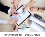 hands of business people at the ... | Shutterstock . vector #146027801