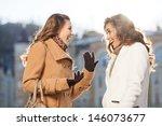 girls gossiping. two beautiful... | Shutterstock . vector #146073677