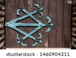wrought iron ornament on wooden ...   Shutterstock . vector #1460904311