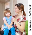 woman scolds her child in home... | Shutterstock . vector #146094341
