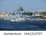 """Small photo of ST.PETERSBURG, RUSSIA - JULY 25, 2018: Anti-diversion boat against the background of the patrol ship (frigate) """"Admiral of the Kasaton fleet"""". Fragment of the dress rehearsal of the"""