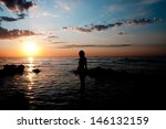girl silhouette at sunset of... | Shutterstock . vector #146132159