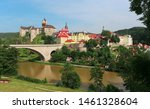 view of the historic Czech town of Loket, a stone medieval castle - a fortress 13th century, a stone bridge over the river Ohre, summer sityscape, popular place near resort Karlovy Vary, Europe