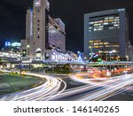 KOBE - NOVEMBER 30: Traffic on Flower Road at Night November 30, 2012 in Kobe, JP. The road connects the foothills and the sea and passes through Sannomiya, the heart of the city. - stock photo