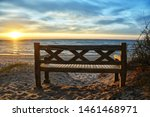 Bench On A Beach At The The...