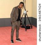 """Small photo of Los Angeles, CA - July 22, 2019: Travis Scott attends The Los Angeles Premiere Of """"Once Upon a Time in Hollywood"""" held at TCL Chinese Theatre"""
