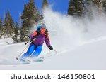 Expert Female Skier Blasting...