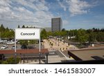 """Small photo of Concord, California / U.S.A - May 23 2019: An image of a """"Concord"""" sign, buildings and the parking lots at the Concord BART station in Concord, California."""