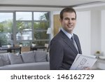 Small photo of Closeup portrait of a confident male estate agent smiling