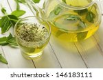 Stock photo healthy green tea cup with tea leaves 146183111