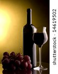 grape a  glass of red wine and a bottle - stock photo