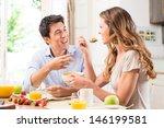 Happy Couple Enjoying Breakfast ...