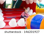 four year old kid playing on a... | Shutterstock . vector #146201927