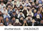 view of crowd covering ears | Shutterstock . vector #146263625