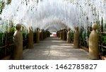 Stone Statue Wiht White Flower...