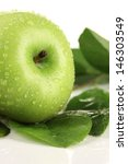 juicy green apple with leaves ...   Shutterstock . vector #146303549