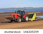 Beach Tractor Pulling Sand Rake