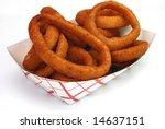 fried onion rings in basket...