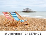 two deckhairs on brighton beach ...