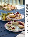 Small photo of Afternoon tea with scones and sandwiches
