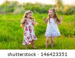 happy kids playing on the lawn | Shutterstock . vector #146423351