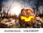Stock photo halloween pumpkin glowing inside in dark autumn forest 146438009