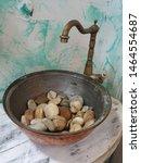 Vintage Washbasin Full Of Ston...