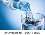 pouring water from bottle into... | Shutterstock . vector #146471507