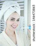 woman brushing her teeth in the ... | Shutterstock . vector #146473865