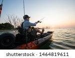 Young Man Kayak Fishing At...