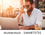 young man at cafe drinking... | Shutterstock . vector #1464873731