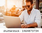 young man at cafe working on... | Shutterstock . vector #1464873734