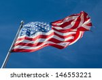 A Usa Flag Flies In A Strong...