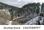 Old wooden railway track in the snowy forest of CloudCroft, New Mexico