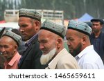 Small photo of Kashgar, China - July 31, 2011: Men at the Sunday Livestock Market in Xinjiang, a very busy market that congregates Uighur farmers from nearby villages that often revolt against Beijing's power.
