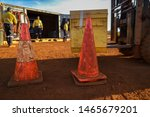 Red and white witches cone hat safety caution traffic sign barrier applying on the ground with defocused worker forklift driving working at the back ground construction site Perth, Australia   - stock photo