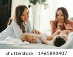 smiling mothers playing with... | Shutterstock . vector #1465893407