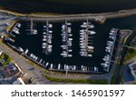 Aerial view of a lot of white boats and yachts moored in marina. Photo made by drone from above. july 2019, Norway, Ørstafjorden(Orstafjord), Ørsta(Orsta), Norway