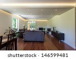 Bright space - a downstairs apartment including a living and a dining room - stock photo