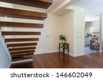 Bright space - elegant wooden stairs in a luxurious house - stock photo
