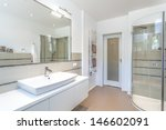 Bright space - a white and beige bathroom with a sink and a shower - stock photo