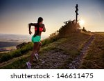 a young woman running in the... | Shutterstock . vector #146611475